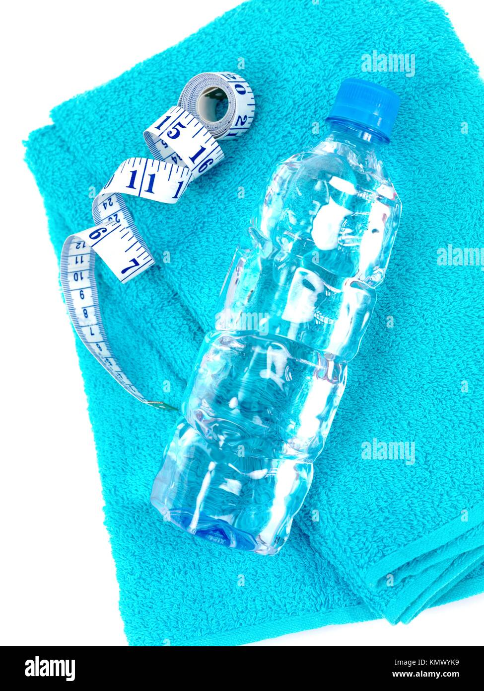 A bottle of water and a sports towel isolated against a white background Stock Photo