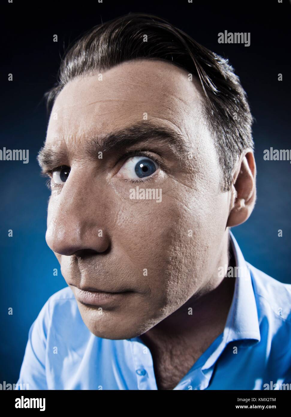 caucasian man observe suspicious portrait isolated studio on black background - Stock Image