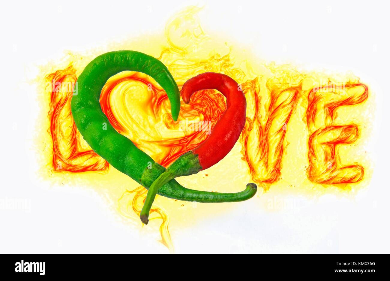 Common Chili  Capsicum annuum  Red and green chilies are kept in heart shape - Stock Image
