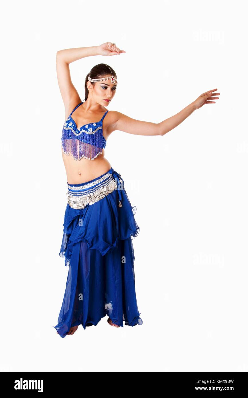 219ebb442 Beautiful Arabic belly dancer harem woman in blue with silver dress and  head jewelry with gem dancing swirling her arms, isolated
