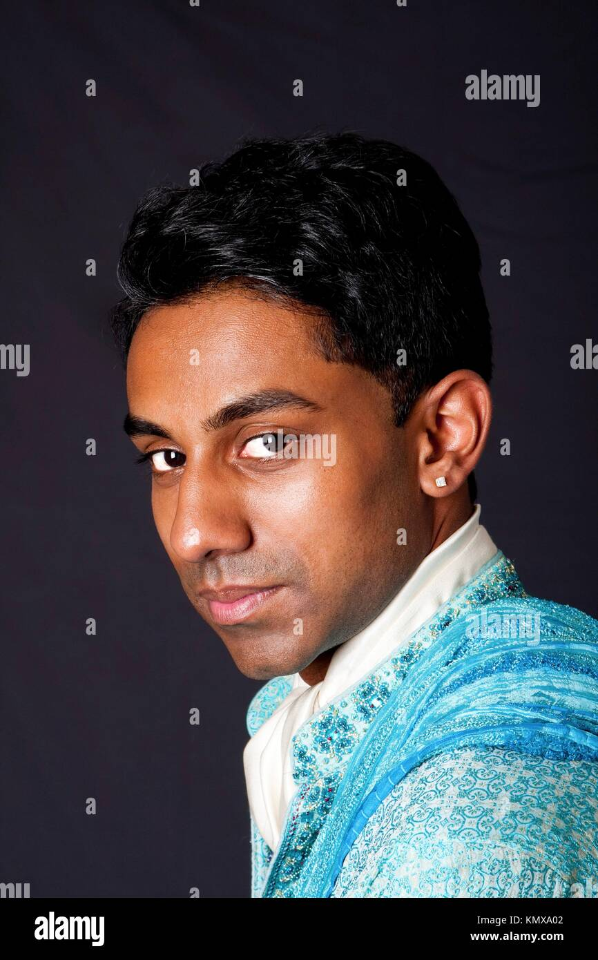 Beautiful Face Of An Indian Hindu Young Man With Earring Wearing Blue Dhoti Portrait Of Handsome