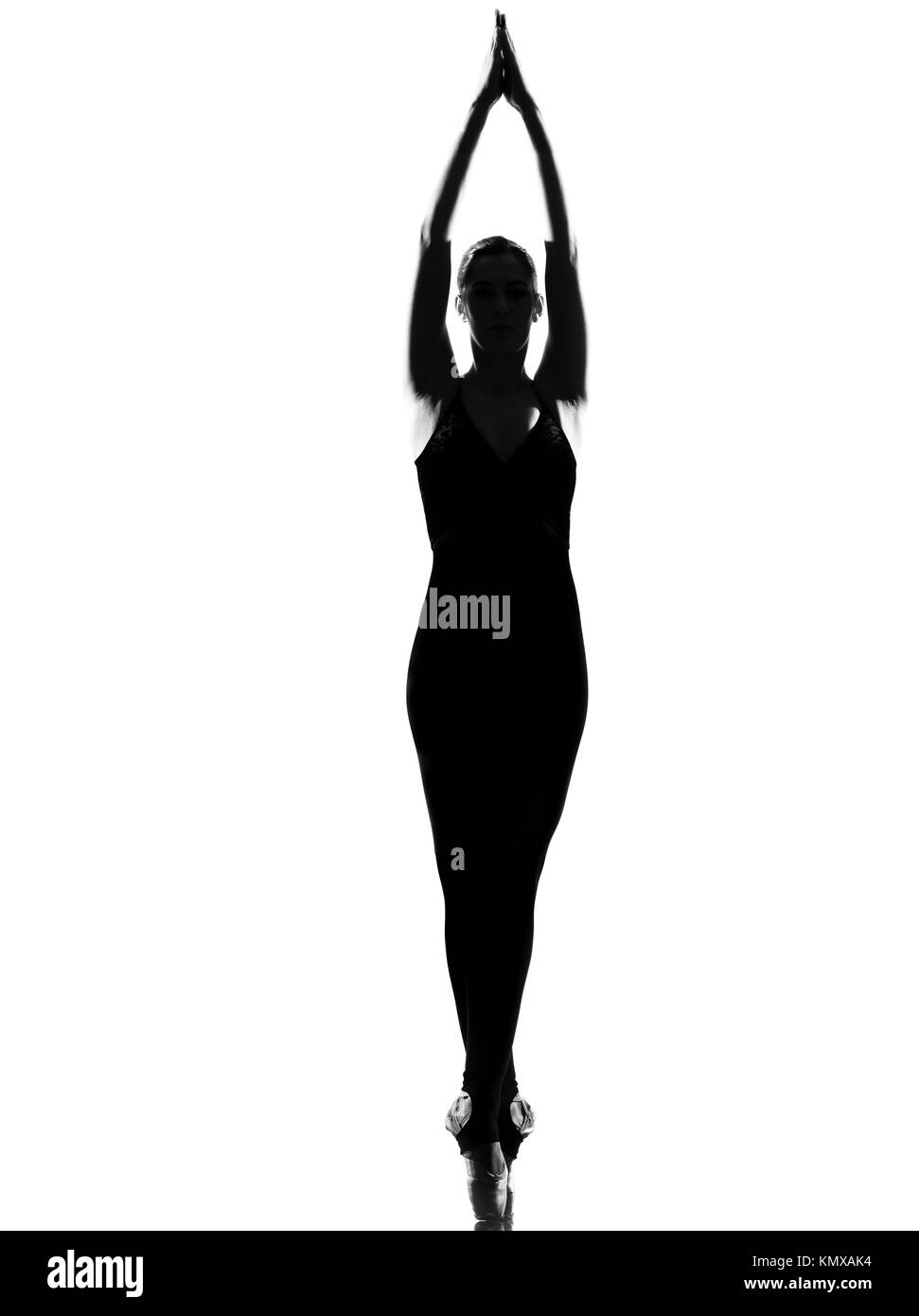 beautiful caucasian tall woman ballet dancer standing tiptoe pose full length on studio isolated white background - Stock Image