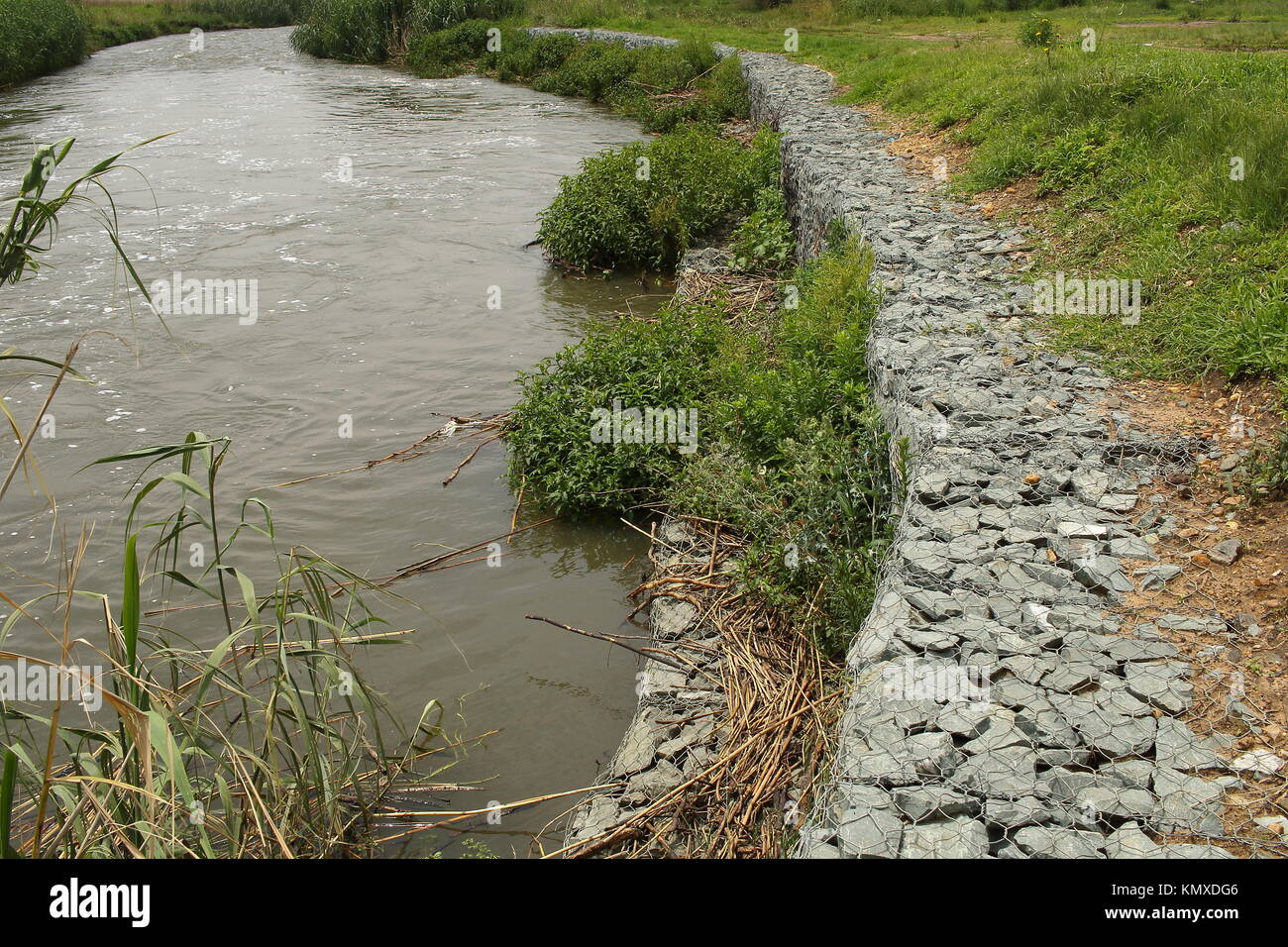 Gabion, cages filled with rocks that are used in erosion control, civil engineering and landscaping image in landscape - Stock Image
