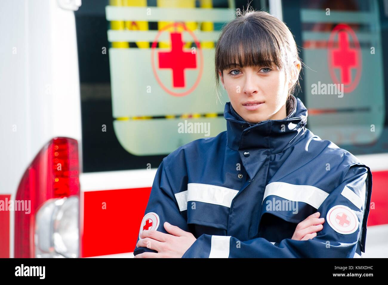 Portrait of a male paramedic, ambulance in the background - Stock Image