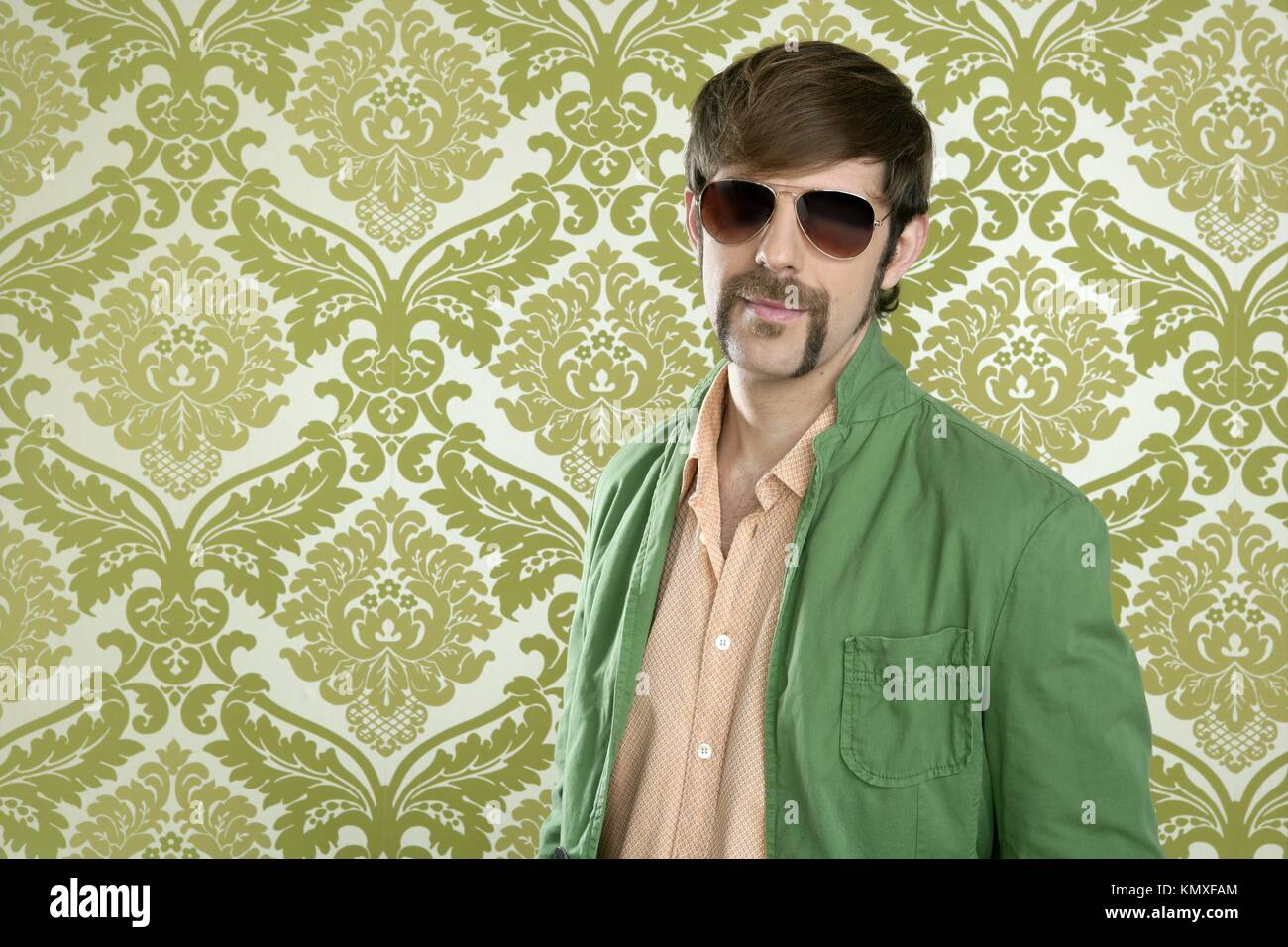 26ea7da652e geek retro salesperson man funny mustache sunglasses in green wallpaper -  Stock Image