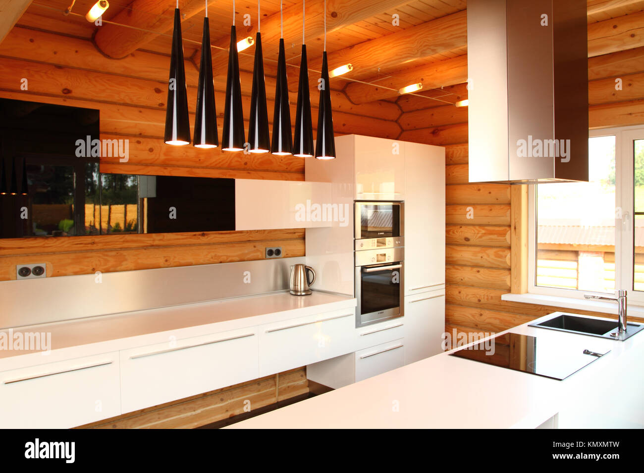 Wide Kitchen In The Wooden House Executed In Style Hight Tech Stock