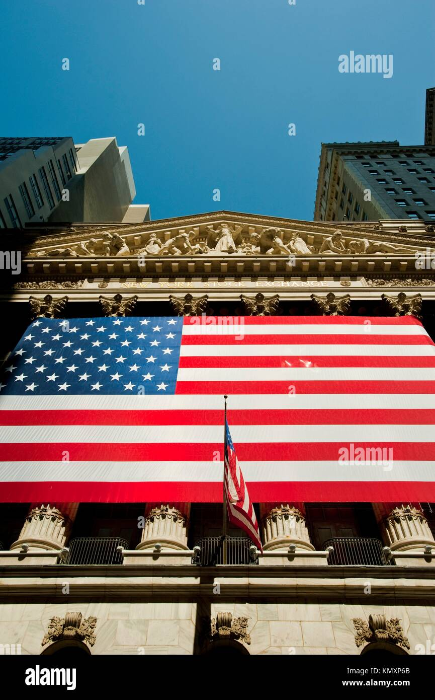 Front of the New York Stock Exchange building draped in the American flag in the financial district in Manhattan, - Stock Image