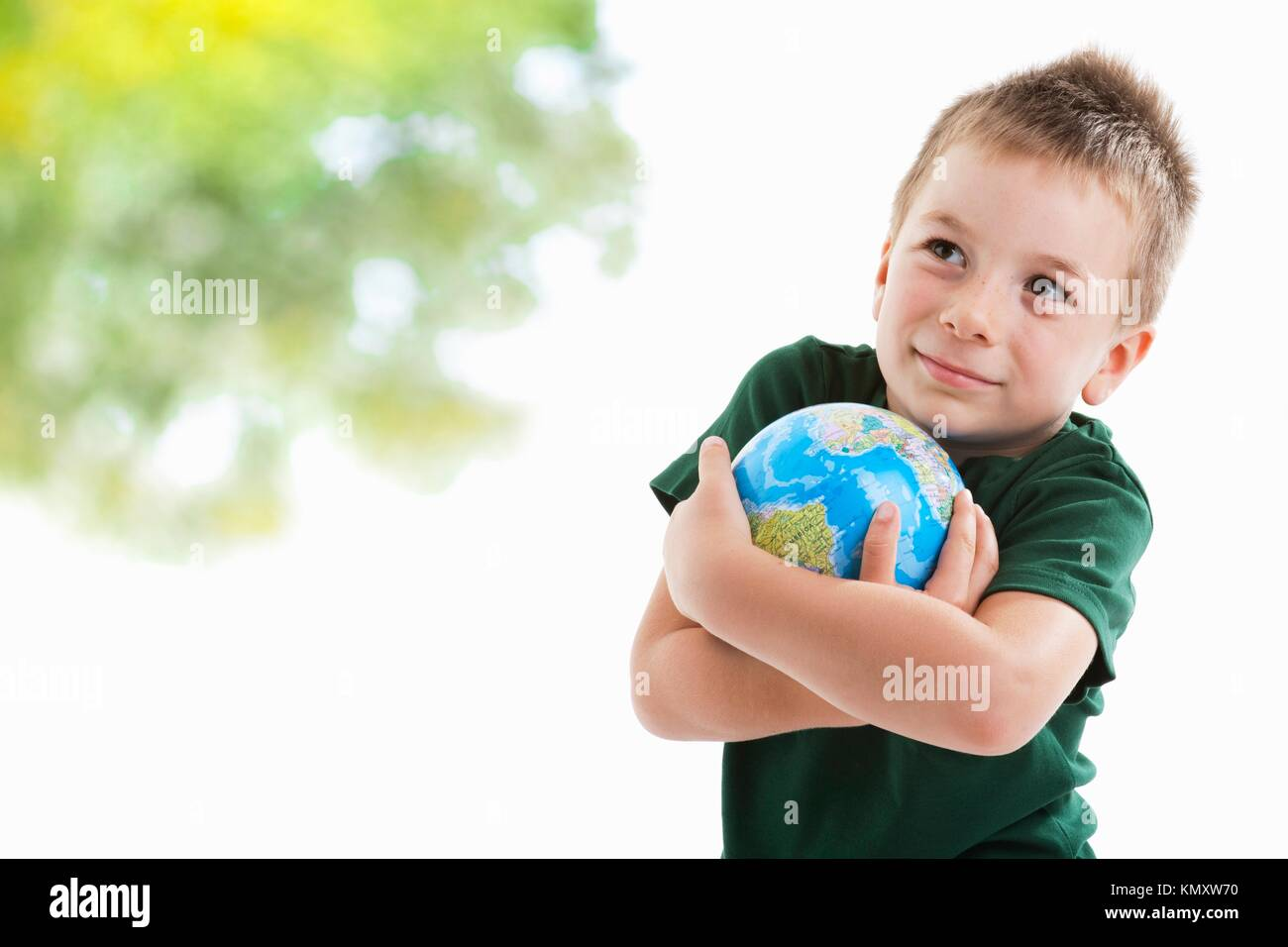 Little boy embracing the globe to protect it Stock Photo