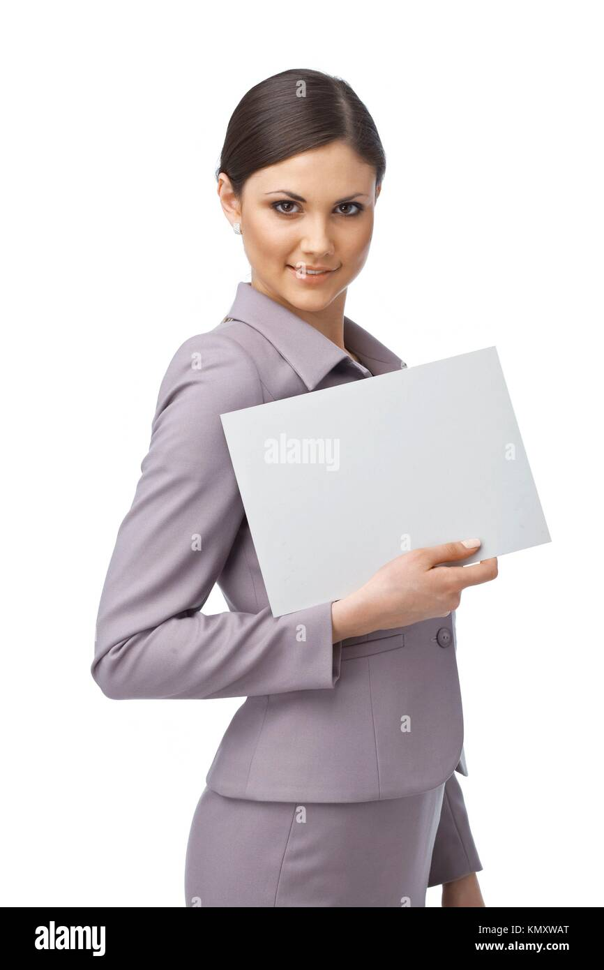 Portrait of an attractive young business woman holding an empty billboard - Stock Image