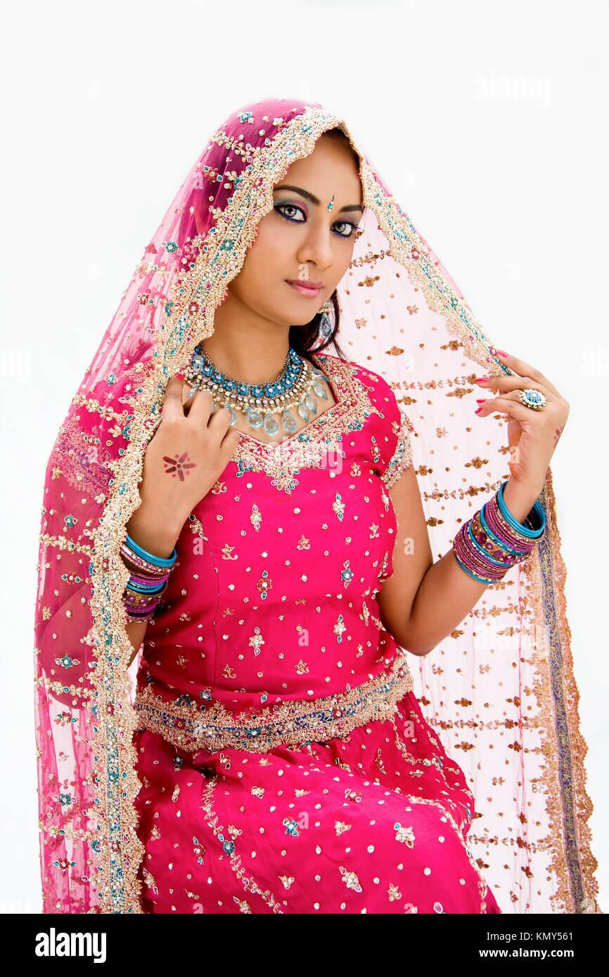 Beautiful Bangali bride in colorful dress and veil, isolated - Stock Image