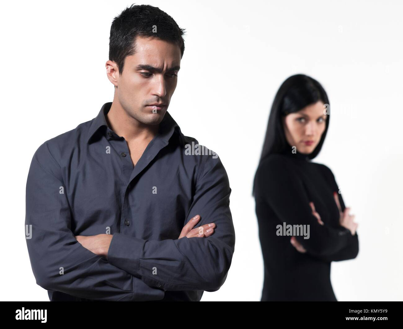 young couple on white background having a dispute - Stock Image