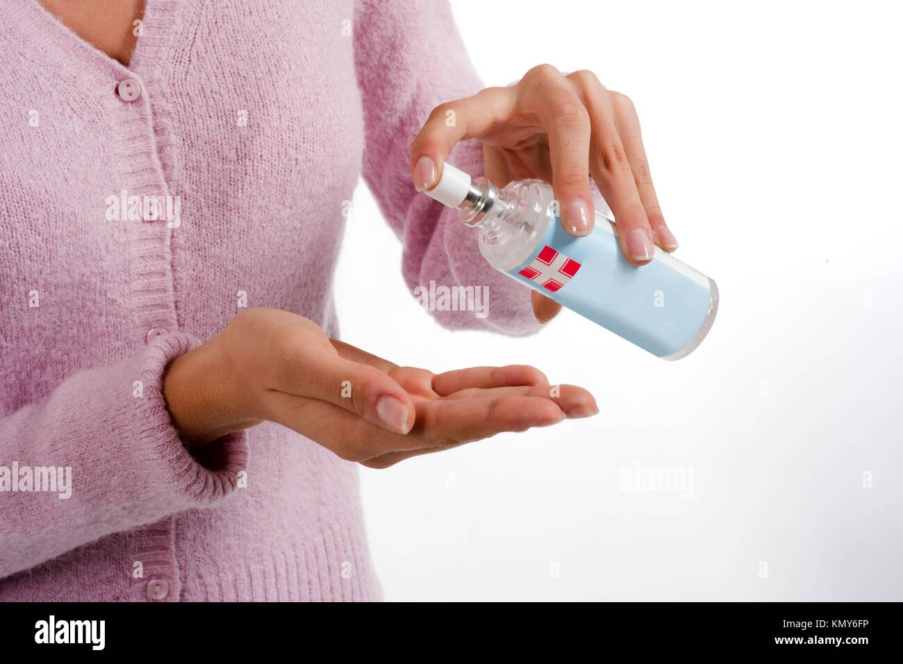 Woman squirts a squirt of antibacterial liquid soap into her palm - Stock Image