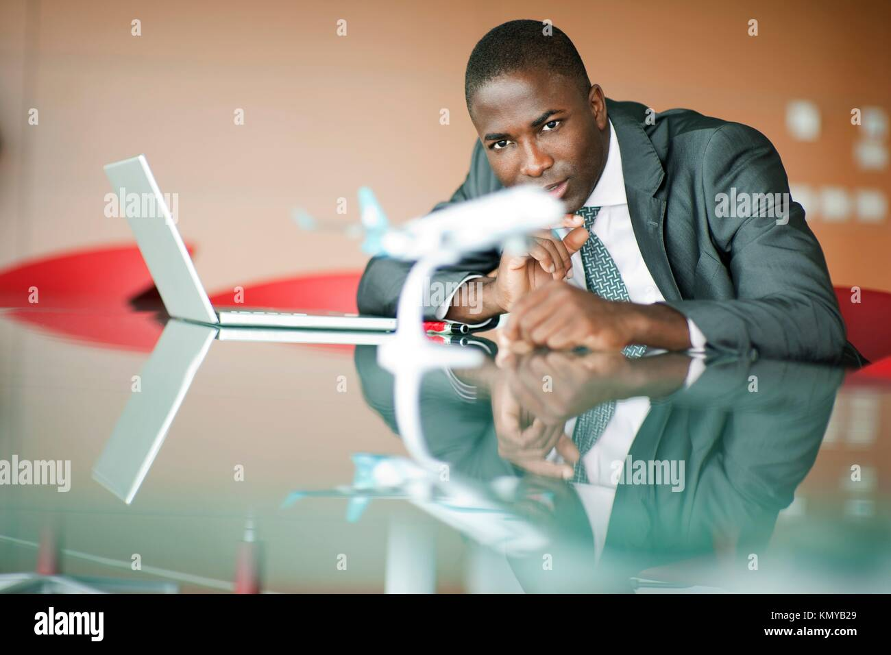 Young engineer with his airplane model - Stock Image