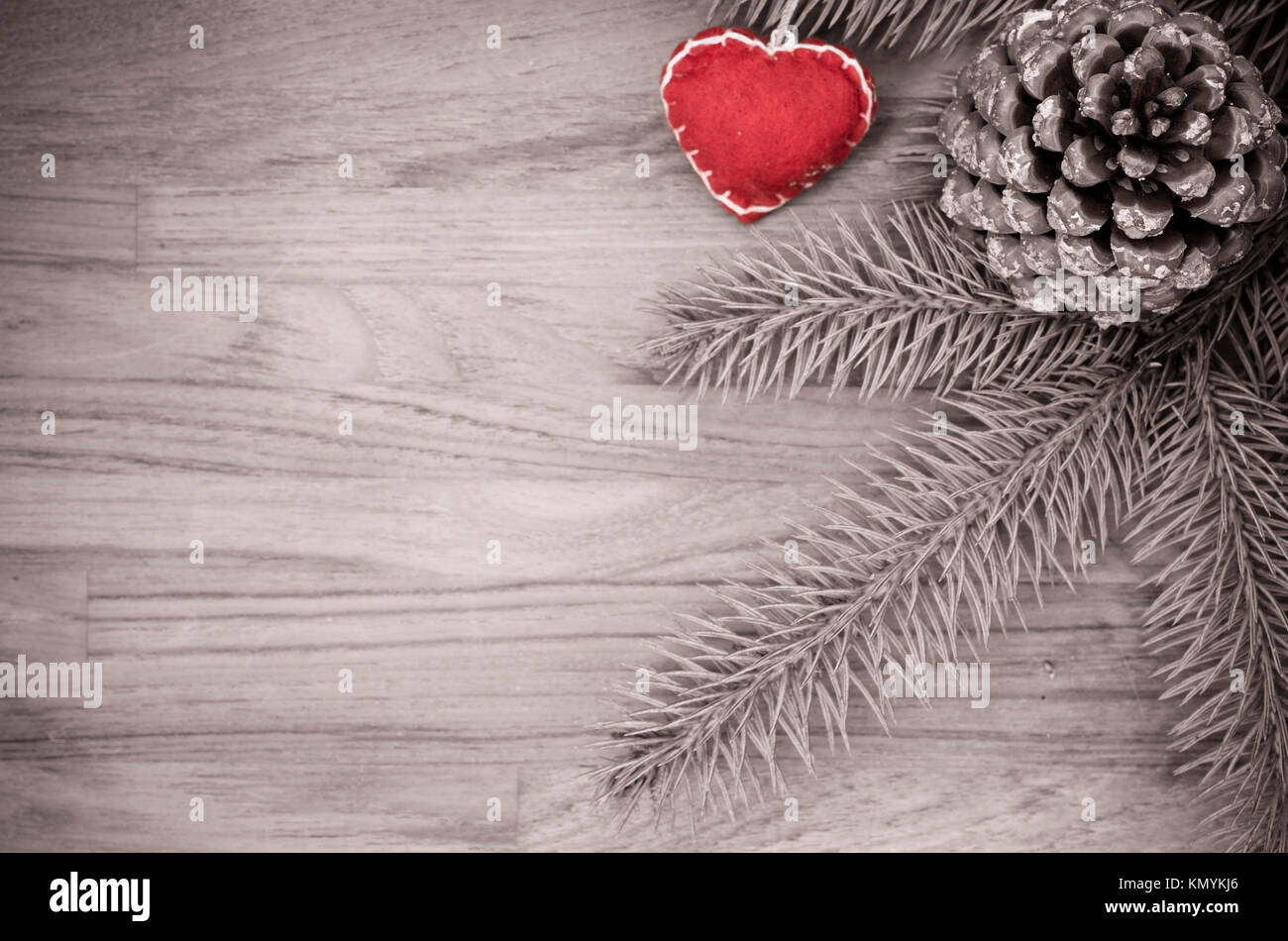 conifer cone and decorations on a fir twigs background - decorative nature backgrounds - Stock Image