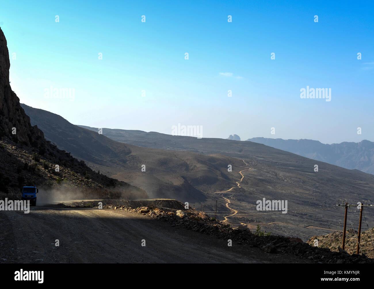 A long dusty rod in Oman - Stock Image