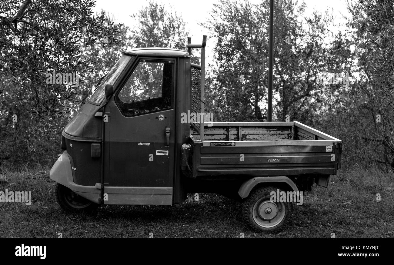 A Piaggio Ape parked in the olive grives above Riva del Garda - Stock Image