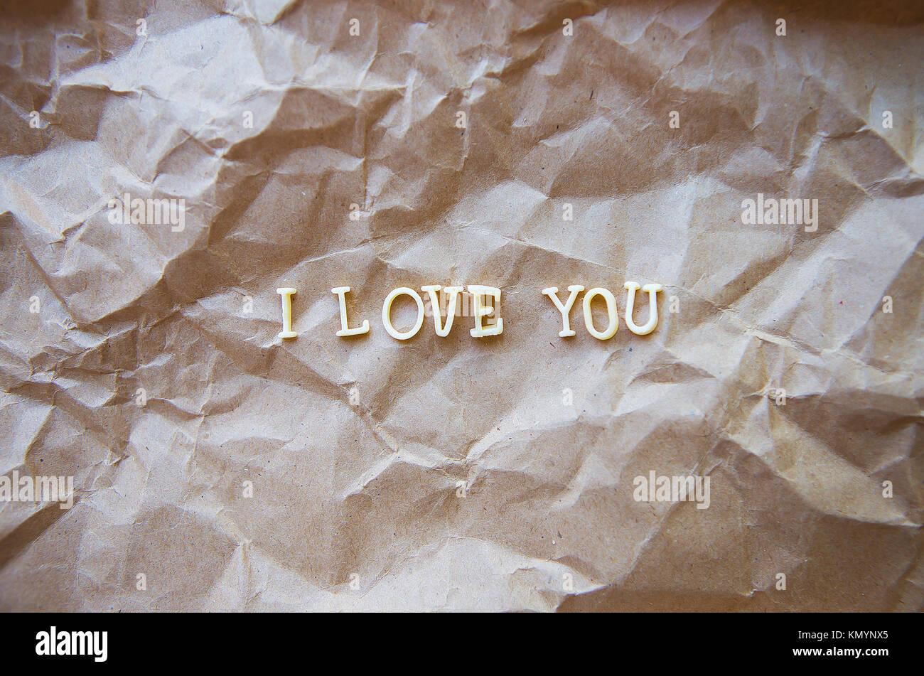 I love you written on kraft paper. - Stock Image
