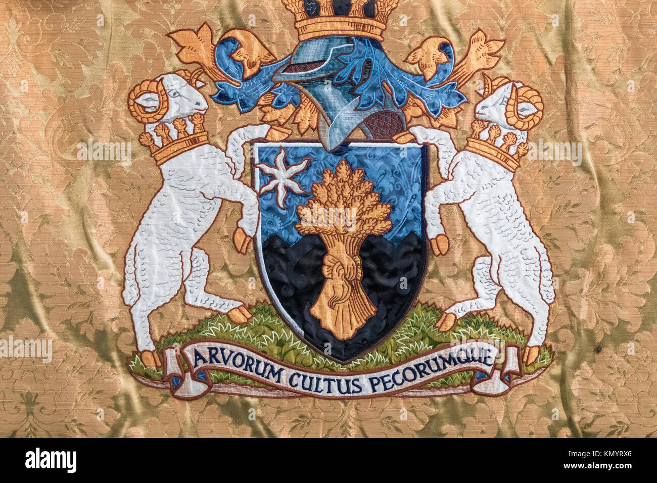 Royal Agricultural University, Cirencester motto Arvorum cultus pecorumque from the University Chapel - Stock Image