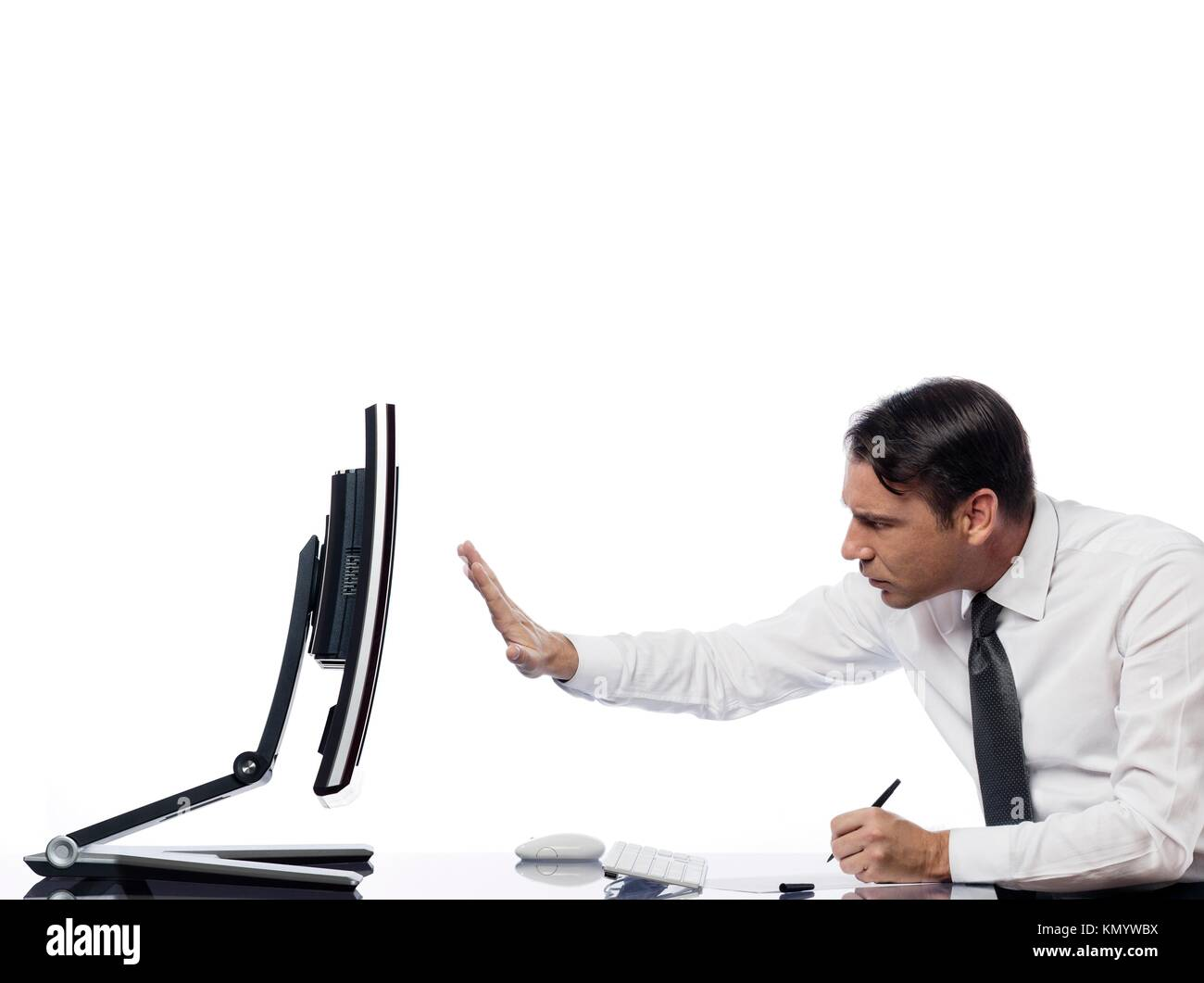 relationship between a caucasian man and a computer display monitor on isolated white background expressing intrusion - Stock Image