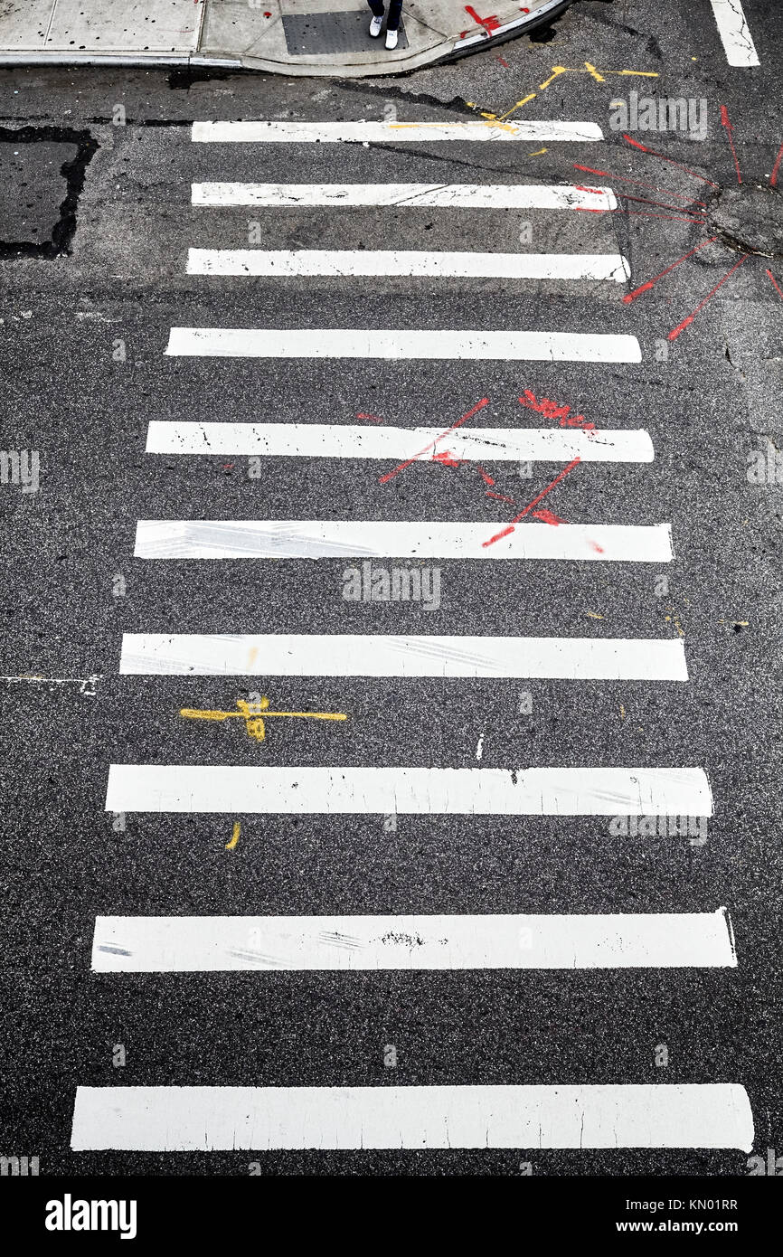 Pedestrian crossing in New York City from above, conceptual background picture. - Stock Image