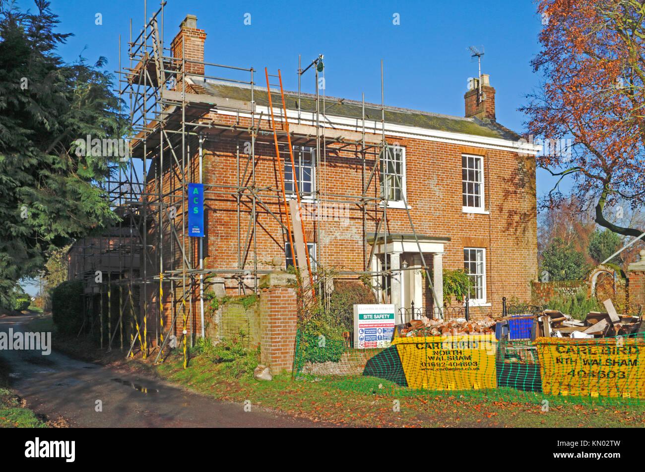 A country house undergoing refurbishment at Briggate, Honing, Norfolk, England, United Kingdom. - Stock Image