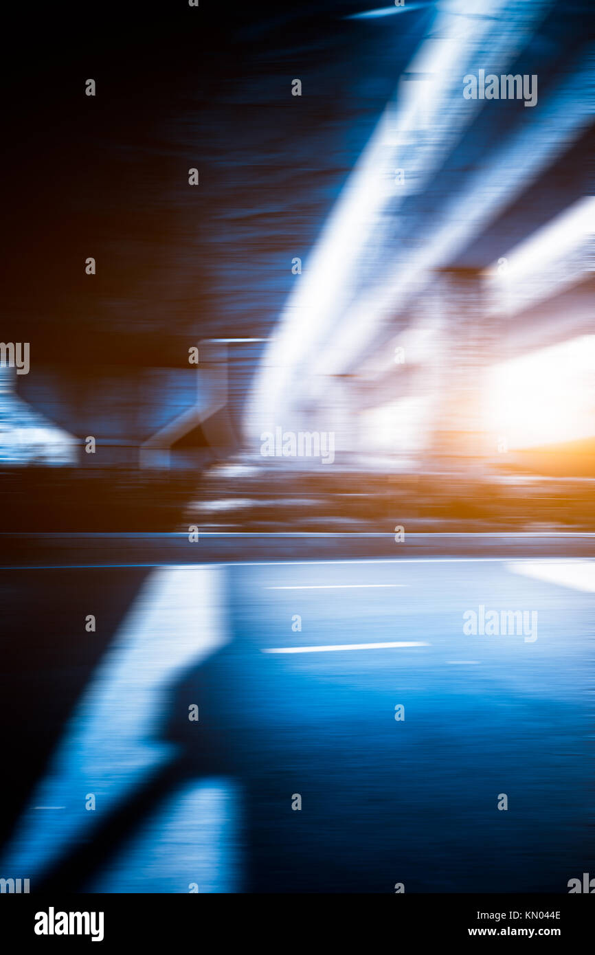 blurred Traffic Road Under Overpasses. - Stock Image
