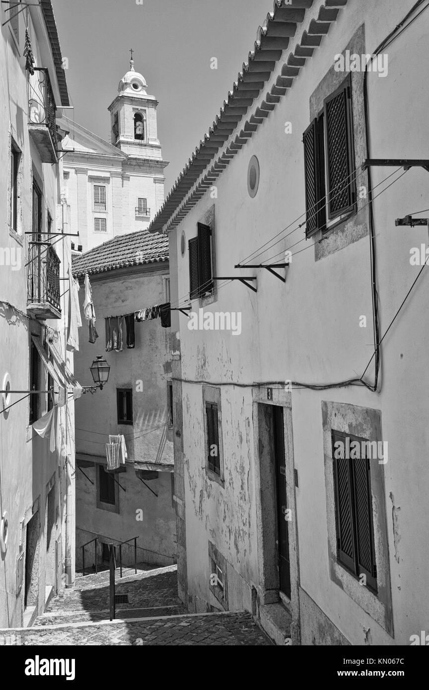 Alfama district, Narrow Street, Lisbon, Portugal - Stock Image