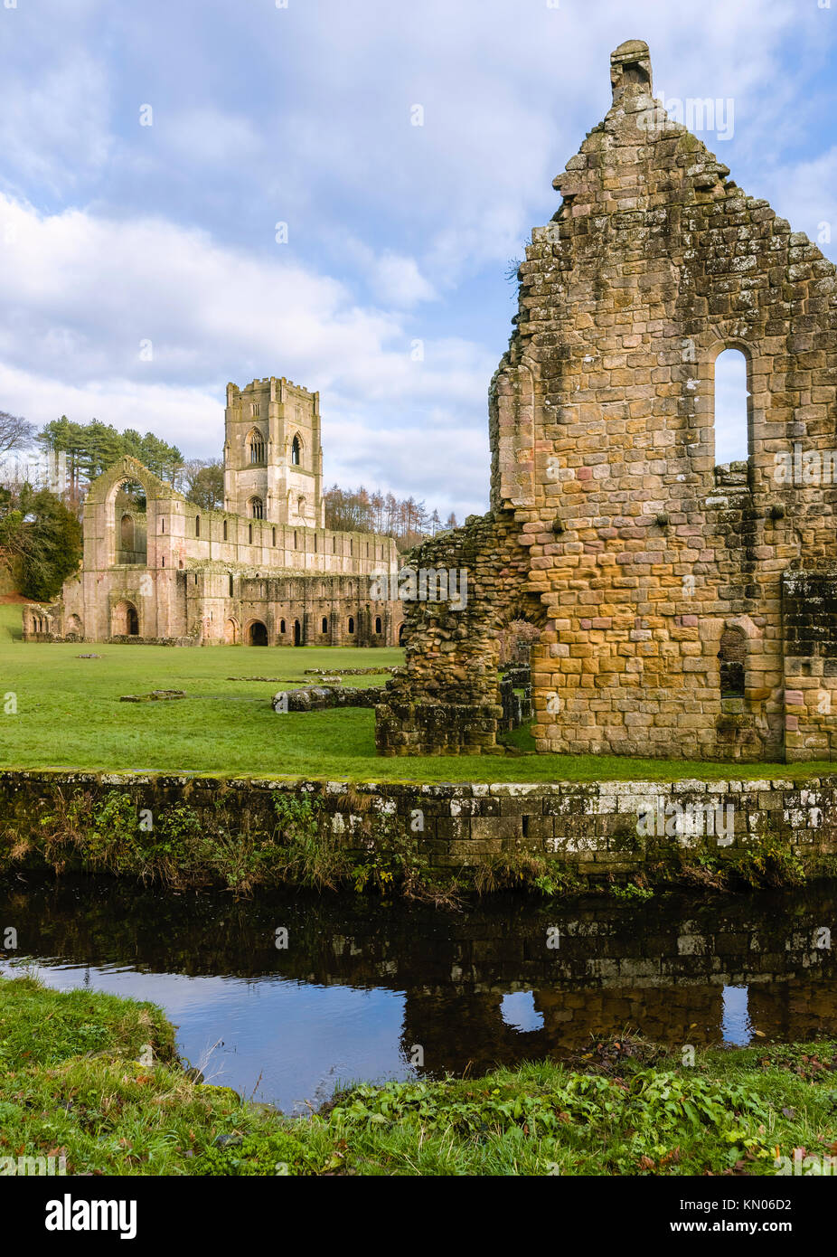 The ruins of Fountains Abbey on a fine autumn morning as viewed from across the river Skell, Ripon, Yorkshire, UK. Stock Photo