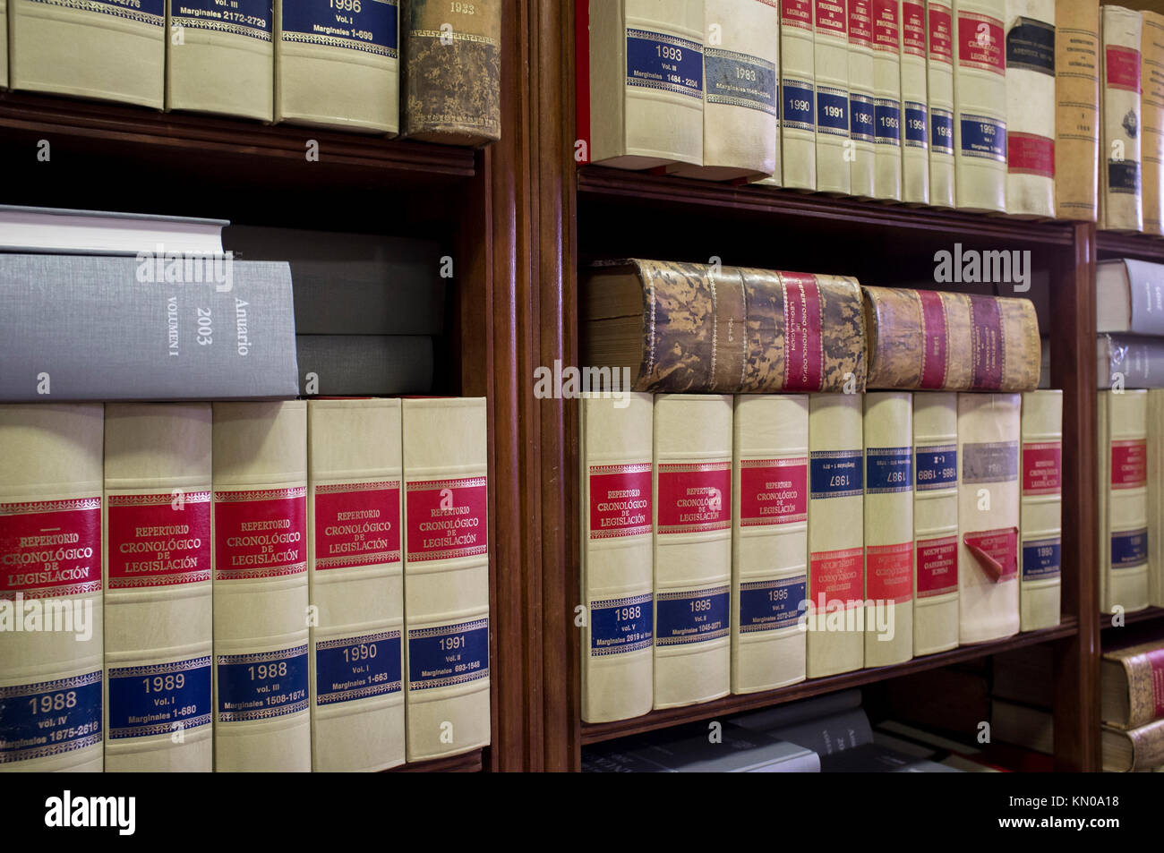 Bookshelf plenty of old legal books. Library law background - Stock Image