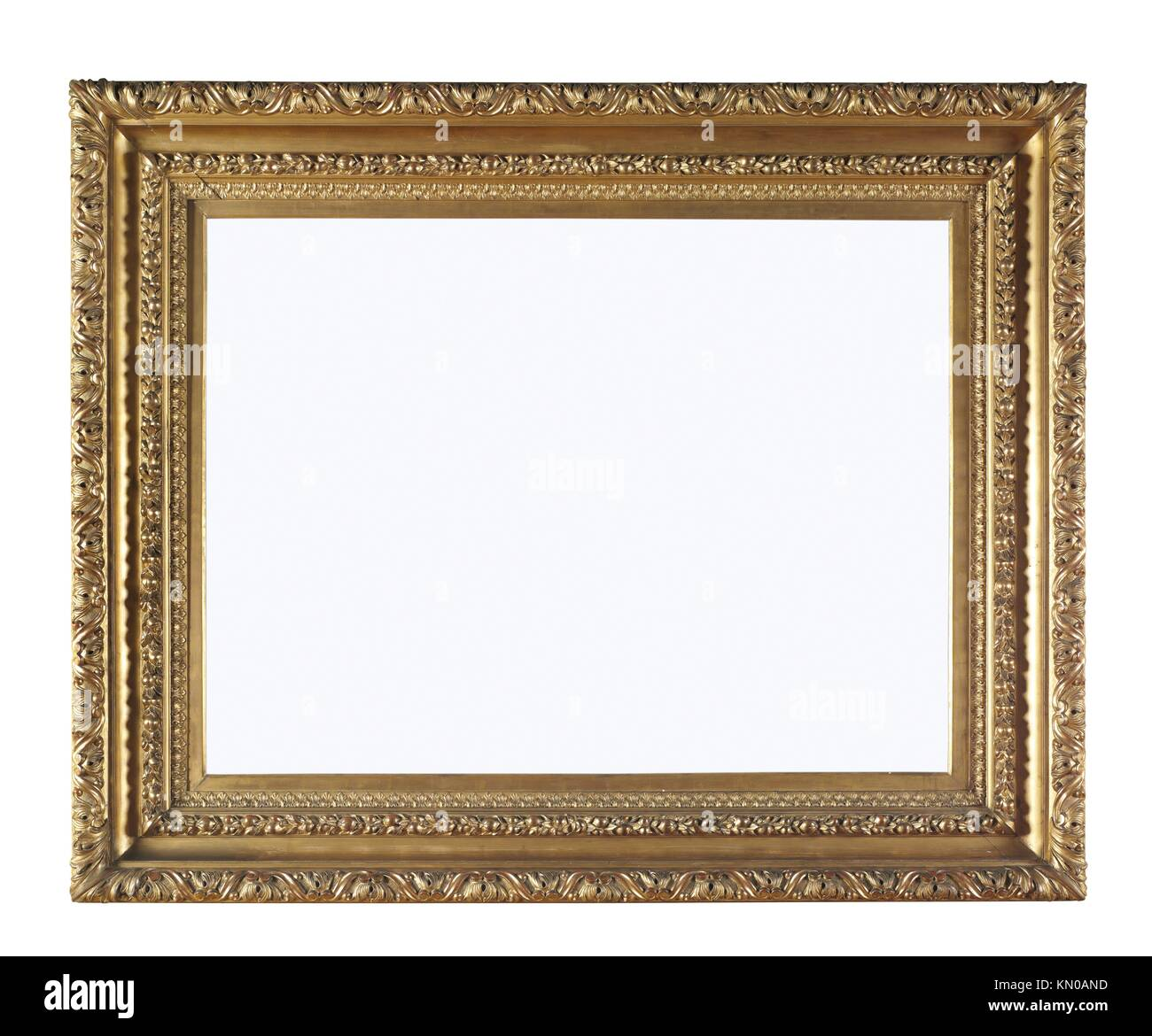 Picture gold frame with a decorative pattern on the wall - Stock Image