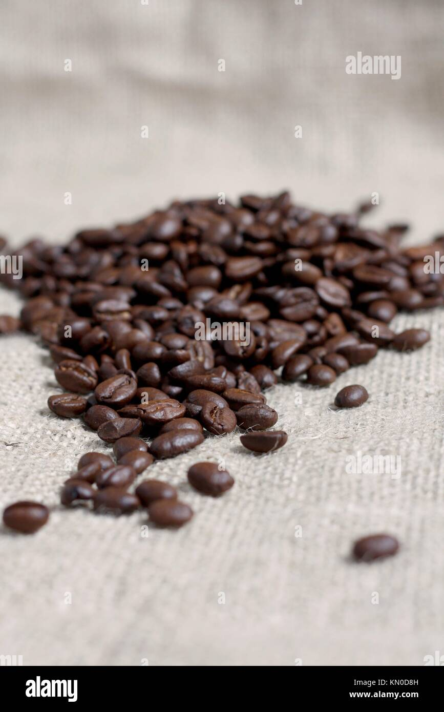 Coffee beans on a coffee bag - Stock Image