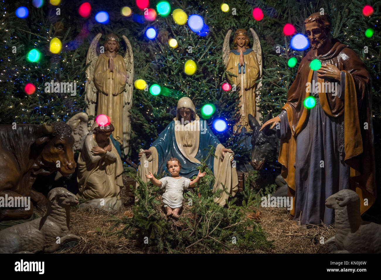 Christmas Nativity Scene With Mary Joseph The Angel Gabriel And Animals Looking Down On