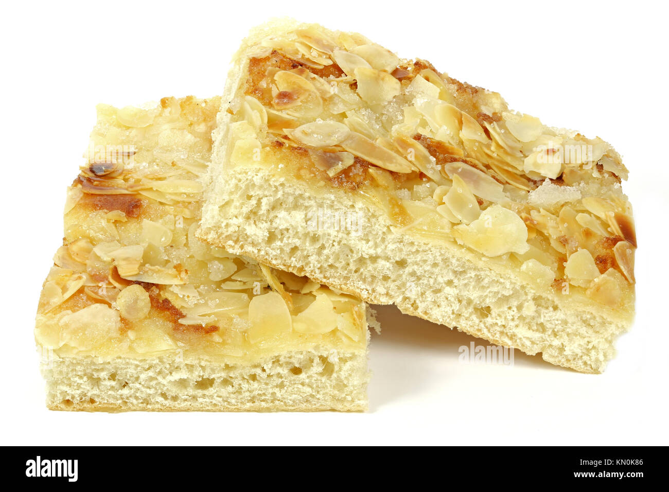 Traditional North German Butterkuchen (butter cake) isolated on white background. - Stock Image