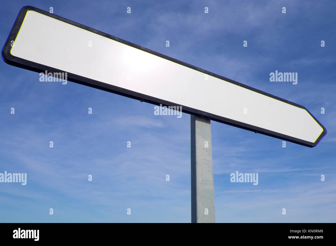 white sign with blue and cloudy sky - Stock Image