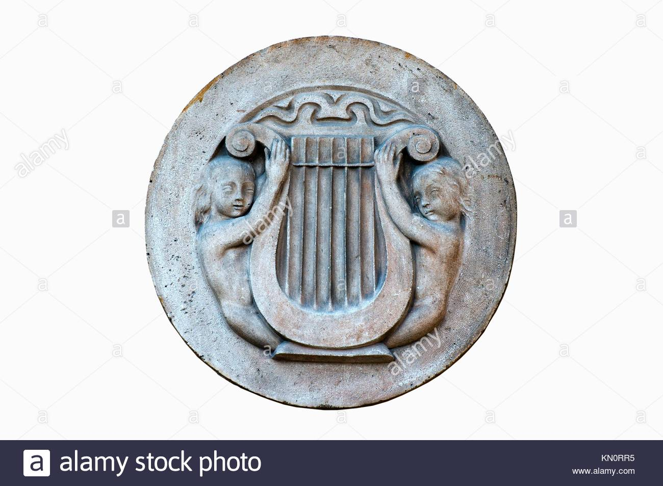Round carving depicting two figures holding a lyre - Stock Image