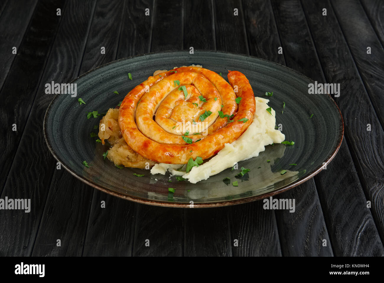 Fried homemade sausage with mashed potato and braised cabbage Stock Photo
