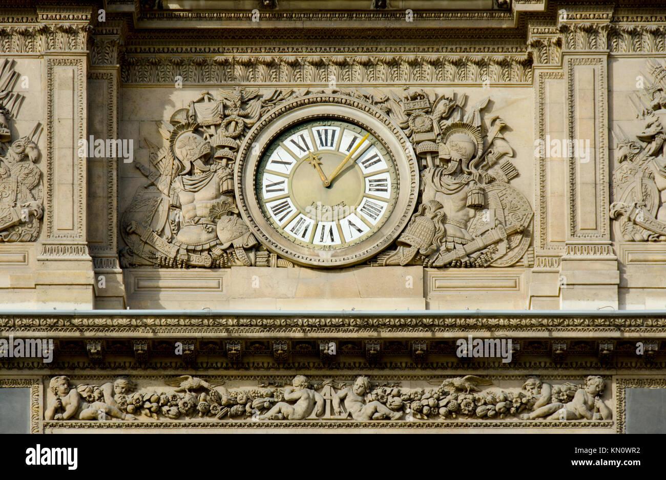 Paris, France. Palais du Louvre. Pavillion de l'Horlogue - clock in the Cour Carree (Jean André Lepaute) - Stock Image