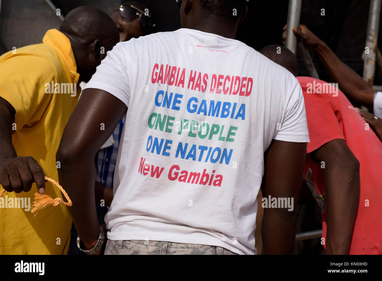 Man wearing T-shirt 'Gambia Has Decided, One Gambia, One People, One Nation, New Gambia' - Stock Image