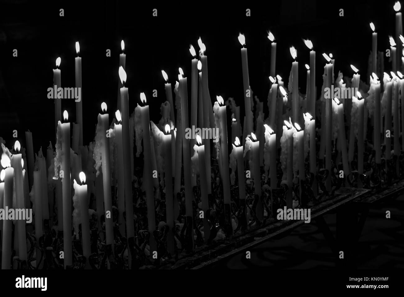 Religious candles in the church - Stock Image