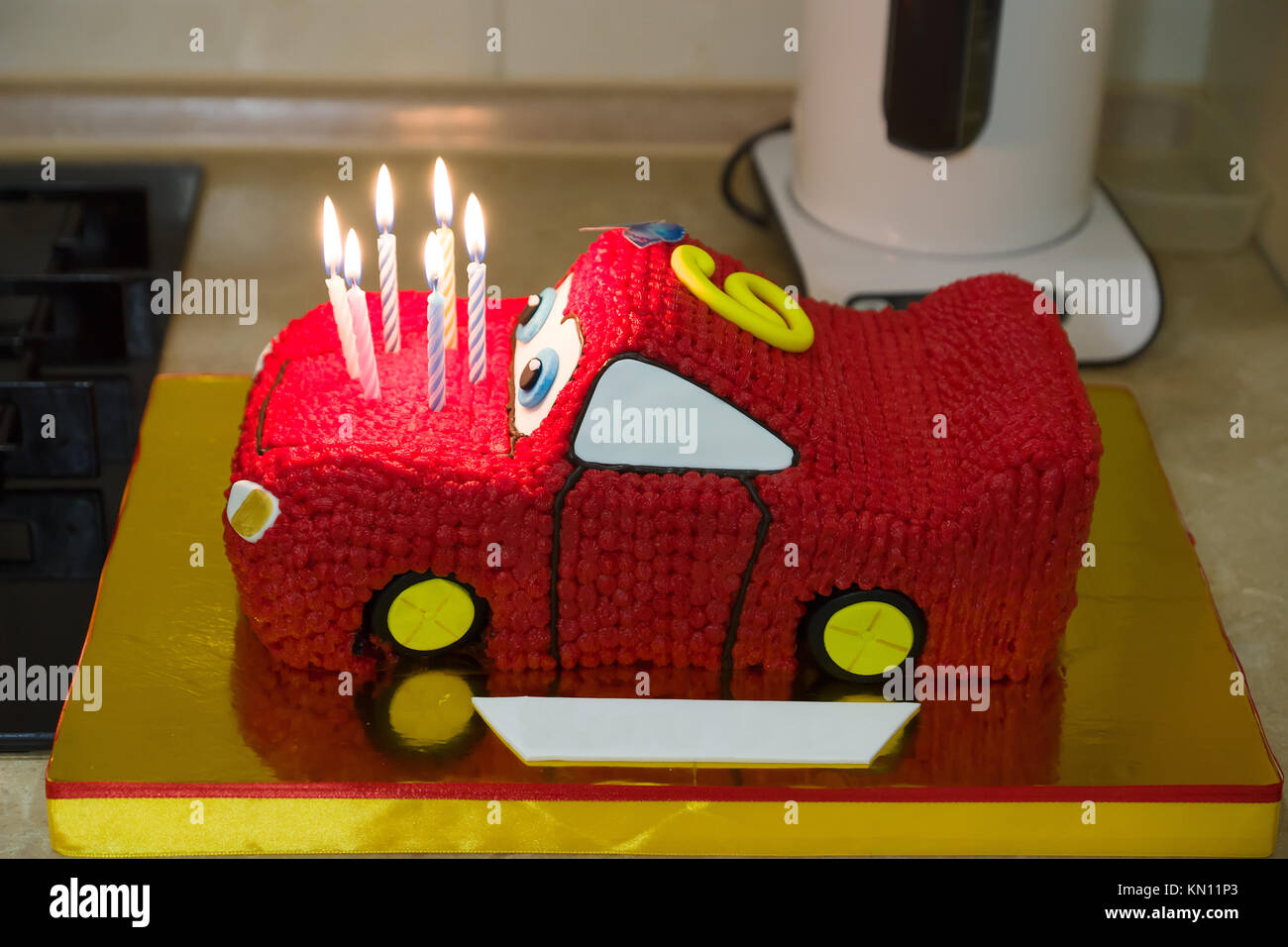 Enjoyable Birthday Cake Made In The Form Of A Sports Car With Candles Stock Personalised Birthday Cards Akebfashionlily Jamesorg