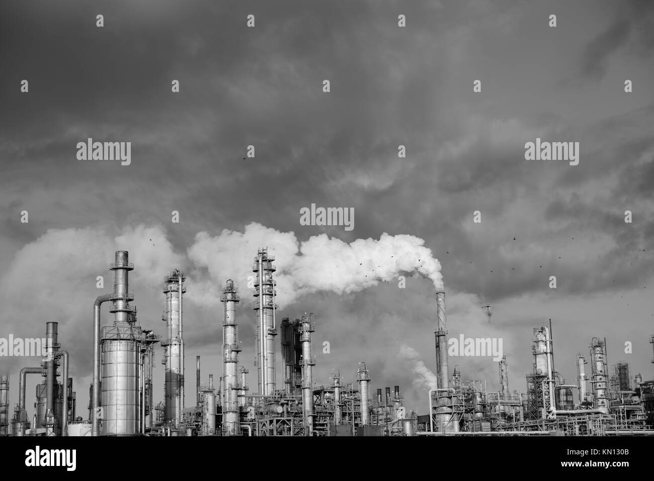 Plume of smoke rising from the smoke stack tower of an industrial oil and gas refinery in Corpus Christi, Texas - Stock Image