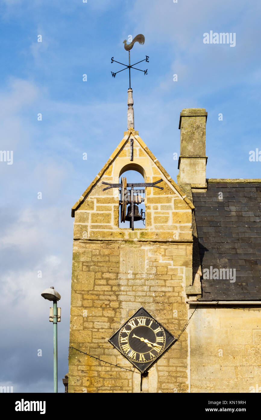 17th century Curfew Bell Tower with clock and weather vane is oldest building in town. Moreton-in-Marsh, Gloucestershire, - Stock Image