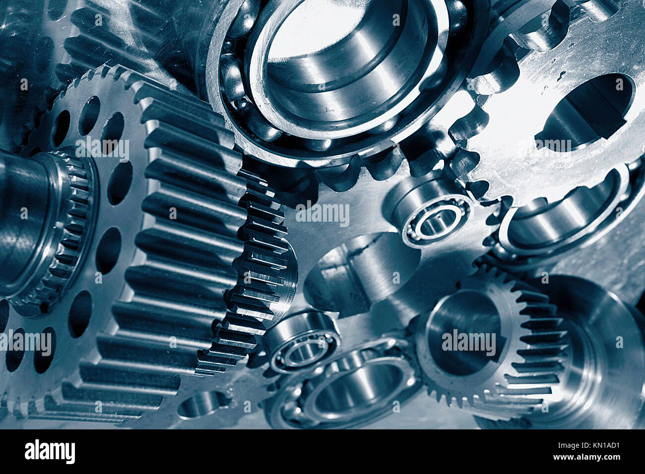 machine parts, gear wheels, cogs and ball bearings against steel, blue toning concept. Stockholm.sweden - Stock Image
