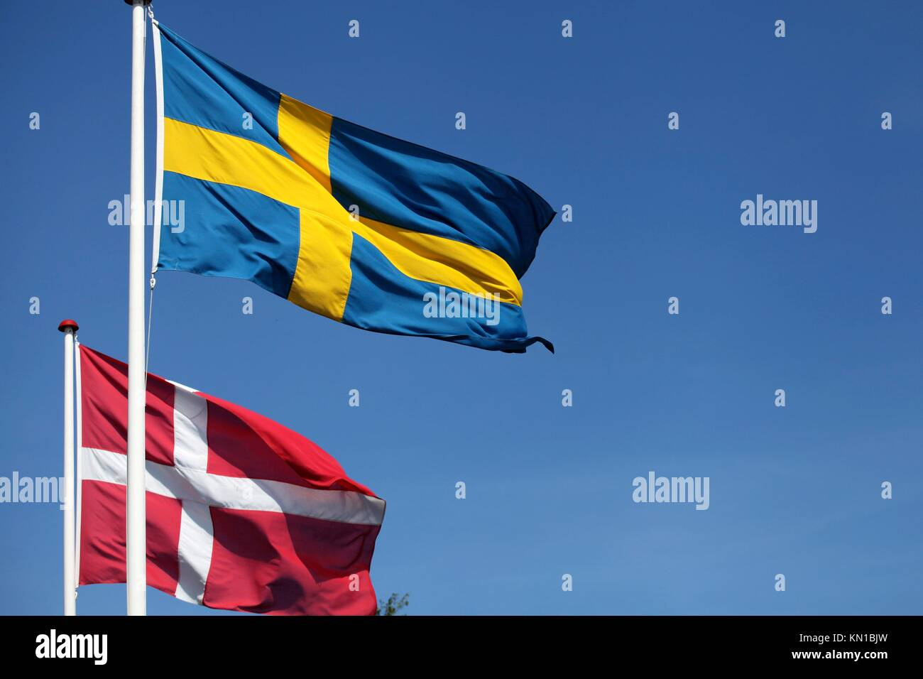 Denmark and Sweden - flags greeting the event - Stock Image