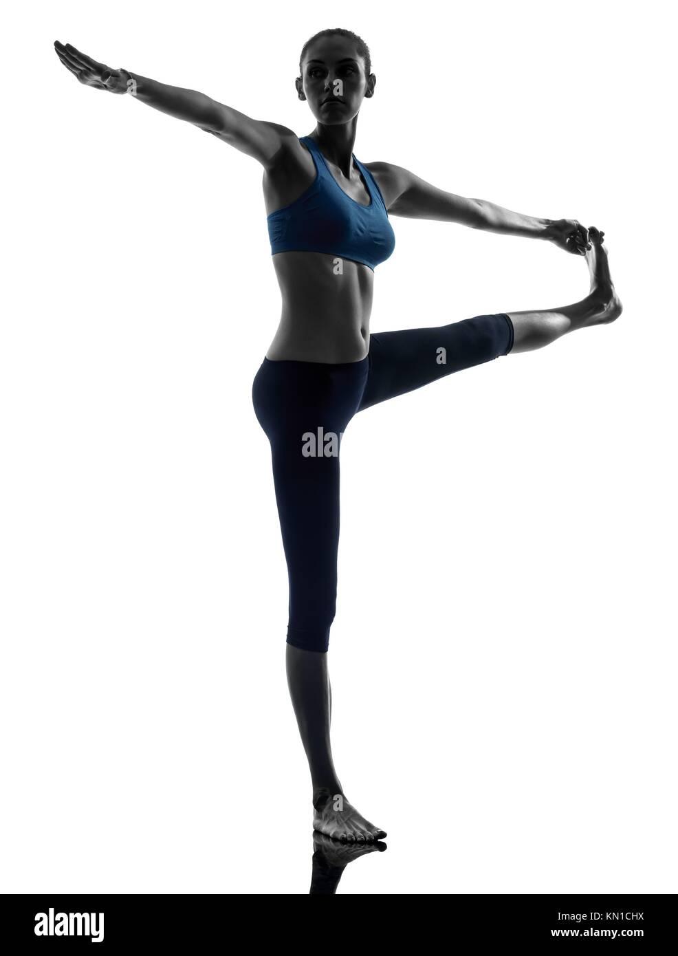 one caucasian woman exercising yoga Hasta Padangusthasana in silhouette studio isolated on white background - Stock Image