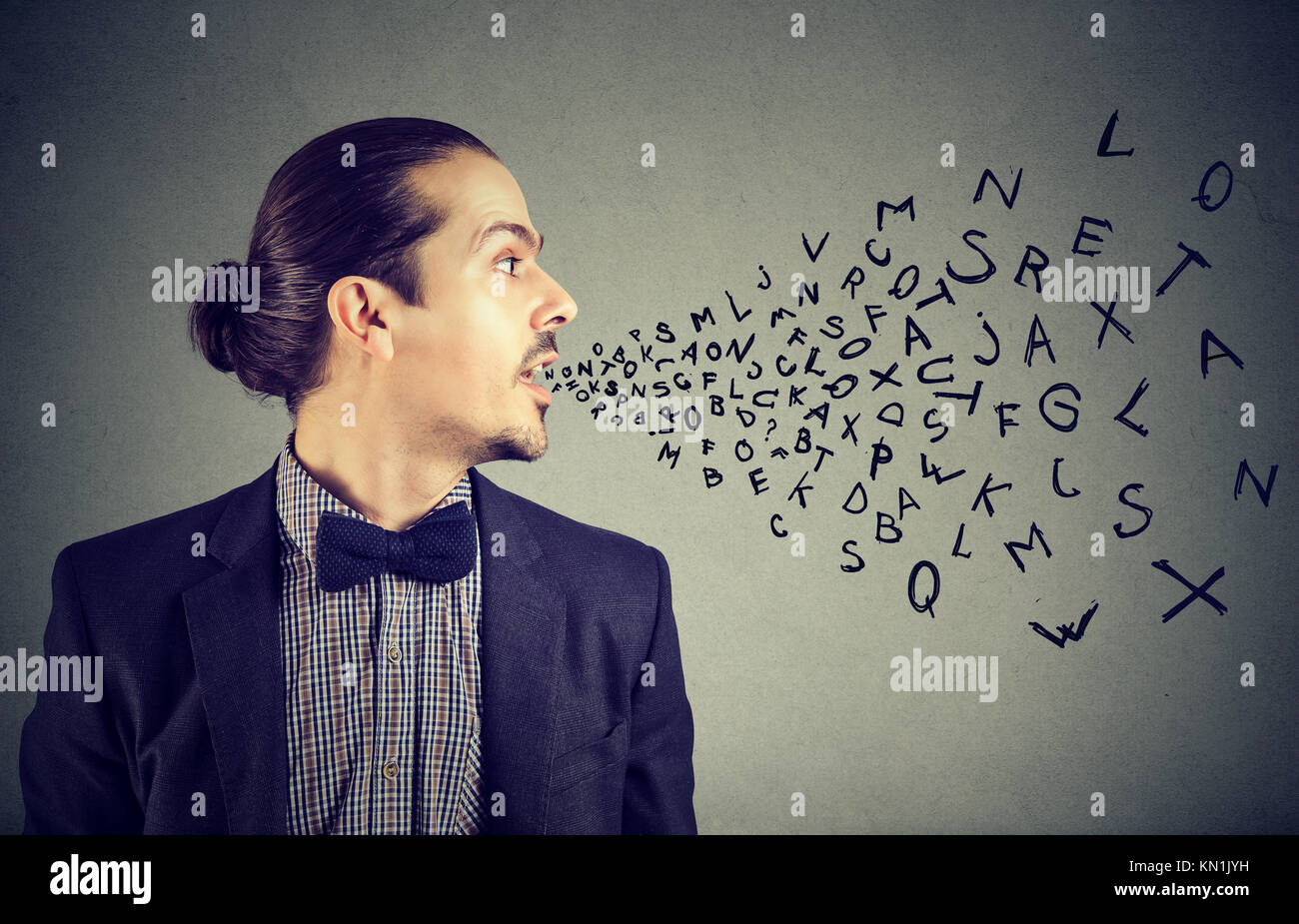 Man talking with alphabet letters coming out of his mouth. Communication, information, intelligence concept - Stock Image