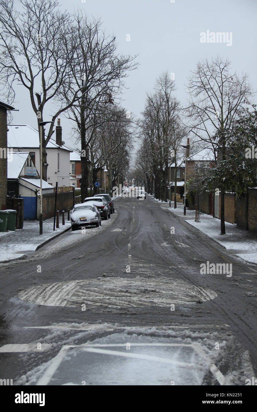 LONDON, UK - DECEMBER 10: Streets of East London were covered with snow from a shower that began at around 3 am - Stock Image
