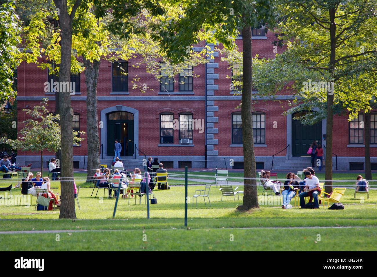 Cambridge, MA, USA - September 27, 2012: Students and tourists rest in lawn chairs in Harvard Yard, the old heart Stock Photo
