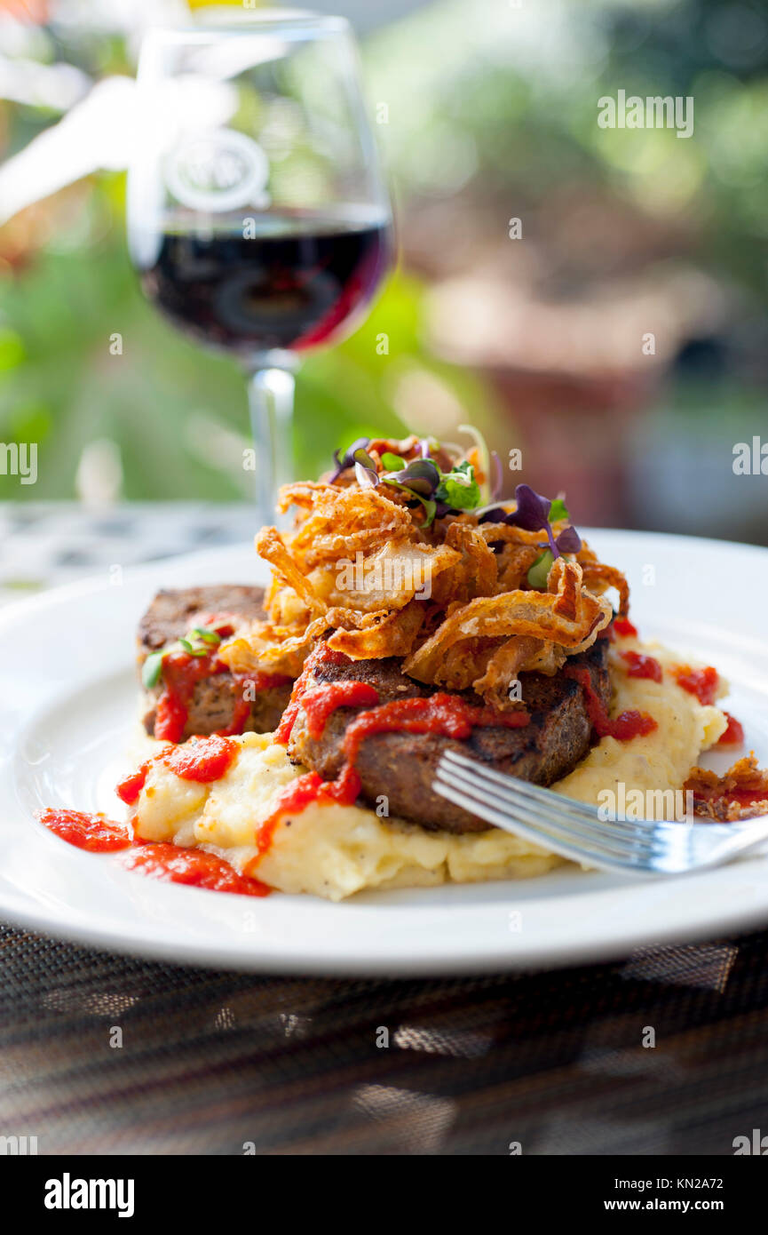 USA Virginia VA Williamsburg Winery dining restaurant wine vineyard food Beef dish with red wine - Stock Image