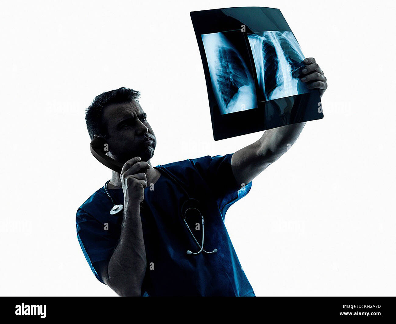 one caucasian man doctor surgeon radiologist medical examaning lung torso x-ray image silhouette isolated on white - Stock Image